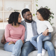 Happy African American Parents Bonding With Their Little Daughter At Home - PhotoDune Item for Sale