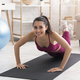 Home training. Happy Latin girl doing push ups on yoga mat indoors - PhotoDune Item for Sale