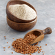 Buckwheat flour in a bowl and buckwheat grain with a spoon - PhotoDune Item for Sale