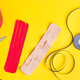 Special physio tapes rolling of different colors and scissors for cutting on a yellow background - PhotoDune Item for Sale