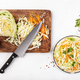 White cabbage salad coleslaw with ingredients cooking on white kitchen table - PhotoDune Item for Sale