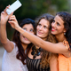 Three young beautiful women as friends together outdoors - PhotoDune Item for Sale