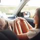 Young woman traveling by car with legs on dashboard. - PhotoDune Item for Sale