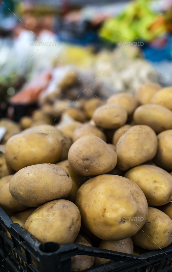Potatoes in cate on the market. - Stock Photo - Images