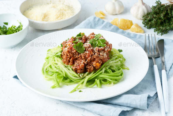 Keto pasta Bolognese with mincemeat and zucchini noodles, fodmap, lchf, low carb - Stock Photo - Images