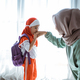 muslim daughter shake hand and kiss mother before going to school - PhotoDune Item for Sale