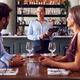 Female Waitress With Digital Tablet Taking Order From Romantic Couple Sitting At Restaurant Table - PhotoDune Item for Sale
