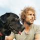 Man having fun with his dog. - PhotoDune Item for Sale
