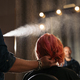 Beautiful woman getting haircut by hairdresser. - PhotoDune Item for Sale