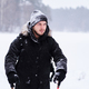 Happy guy doing trekking next to a the snowy forest - PhotoDune Item for Sale