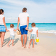Photo of happy family having fun on the beach. Summer Lifestyle - PhotoDune Item for Sale