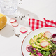 selective focus of fresh radish salad with greens and avocado on plate - PhotoDune Item for Sale