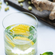selective focus of fresh ginger lemonade in glass with lemon - PhotoDune Item for Sale