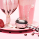 Disposable cup and glass of milkshakes, strawberry and scoop on plate - PhotoDune Item for Sale