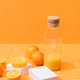 fresh orange juice in glass and bottle near ripe oranges - PhotoDune Item for Sale