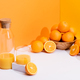 fresh orange juice in glass and bottle near ripe oranges in bowl - PhotoDune Item for Sale