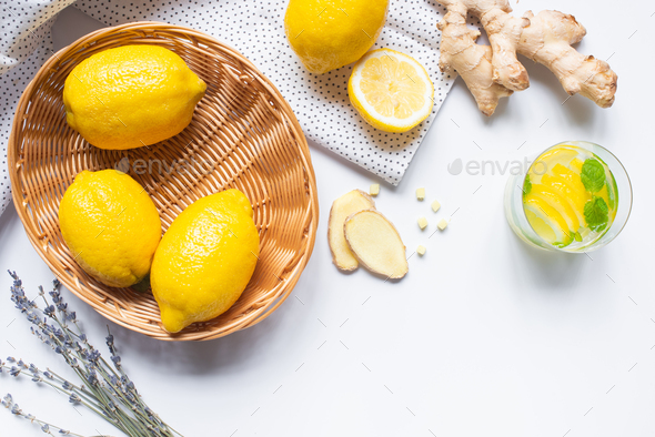 top view of fresh lemonade in glass near basket of lemons - Stock Photo - Images