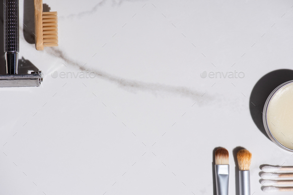 Top view of cosmetic brushes, toothbrush, razor, jar of wax - Stock Photo - Images
