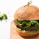 selective focus of delicious green vegan burger with microgreens - PhotoDune Item for Sale