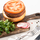 selective focus of delicious vegan burger with radish, tomato and microgreens - PhotoDune Item for Sale