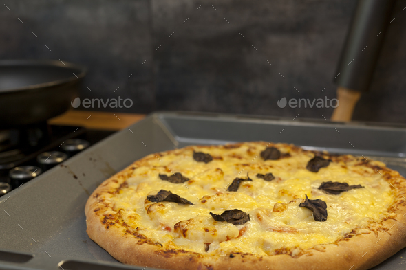 Baked quattro formaggi pizza in rectangular oven griddle - Stock Photo - Images