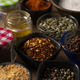 Different Spices in small bowls on a wooden table - PhotoDune Item for Sale