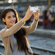 Young beautiful Asian woman at the railway station - PhotoDune Item for Sale