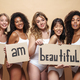 Image of young multinational women smiling and holding placards - PhotoDune Item for Sale