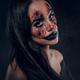 Portrait of evil creepy clown at dark photo studio - PhotoDune Item for Sale
