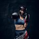 Portrait of nice female boxer at dark photo studio - PhotoDune Item for Sale