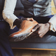 Elegant man is putting on his shoes - PhotoDune Item for Sale