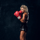 Portrait of professional female boxer in action - PhotoDune Item for Sale