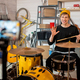 Happy young man with drumsticks sitting by drumset in front of smartphone camera - PhotoDune Item for Sale