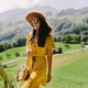 attractive woman in summer dress travel countryside and green meadow - PhotoDune Item for Sale