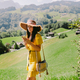 woman using smartphone on summer vacations and travel in countryside green meadow village - PhotoDune Item for Sale