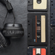 Headphones and compact cassettes on black slate background - PhotoDune Item for Sale