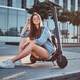 Attractive girl is sitting on her own scooter - PhotoDune Item for Sale