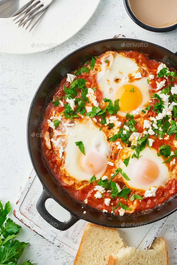 Shakshouka, eggs poached in sauce of tomatoes, olive oil. Mediterranean cousine. - Stock Photo - Images
