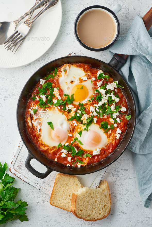 Shakshouka, eggs poached in sauce of tomatoes, olive oil. Mediterranean cuisine. - Stock Photo - Images