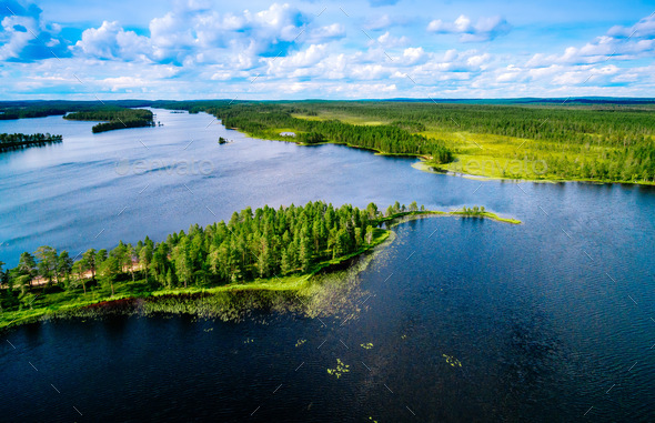 Aerial top view of blue lakes with islands and green forests in Finland. - Stock Photo - Images