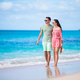 Young couple on white beach. Happy family on honeymoon vacation - PhotoDune Item for Sale