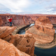 Man sitting on a cliff over Colorado river in Horseshoe bend canyon - PhotoDune Item for Sale