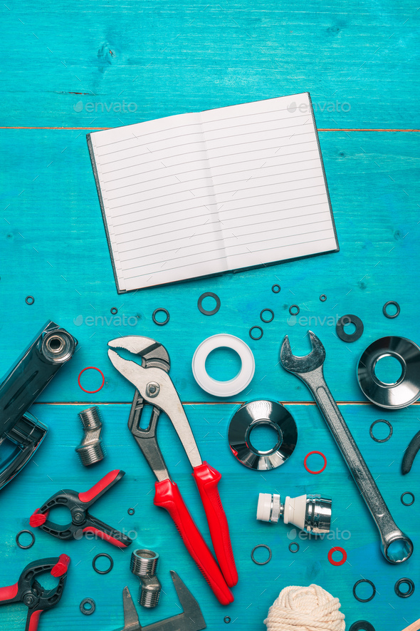 Plumbing tools and blank notebook mock up - Stock Photo - Images