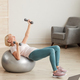Woman training at home - PhotoDune Item for Sale