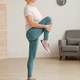 Mature woman doing stretching exercises at home - PhotoDune Item for Sale
