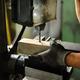 Worker drilling an aluminium block - PhotoDune Item for Sale