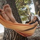Young woman relaxing in a hammock hanging between trees - PhotoDune Item for Sale