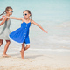 Happy kids running and jumping at beach - PhotoDune Item for Sale