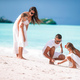 Happy beautiful family with kids on the beach - PhotoDune Item for Sale