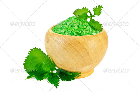Salt in the green wood bowl with nettle - Stock Photo - Images